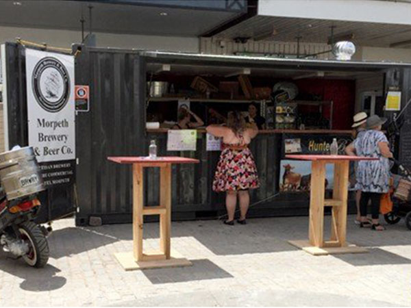 With a pop-up container shop, you can follow the crowds and start trading immediately. This pop-up container shop was used by Maitland Council at their yearly 'Taste' event as a makeshift bar called The Hunter and the Hare. Fully insulated, it includes a lockable servery window, fold down deck, work bench with kitchen sink, flush fit personnel door with deadlock and waterproof floor with floor waste outlet. This pop-up container shop is perfect for restaurants, cafes and bars, but they're also ideal for pop-up retail outlets featuring goods like clothing, shoes, accessories, homewares, and arts & crafts. A big advantage of these units is that they are extremely secure and have the ability of being transported from site to site. Choose from three standard 10′, 20′ and 40′ container sizes. Call us today and speak to one of our friendly staff at Port Shipping Containers for a quote and be on your way to selling today!